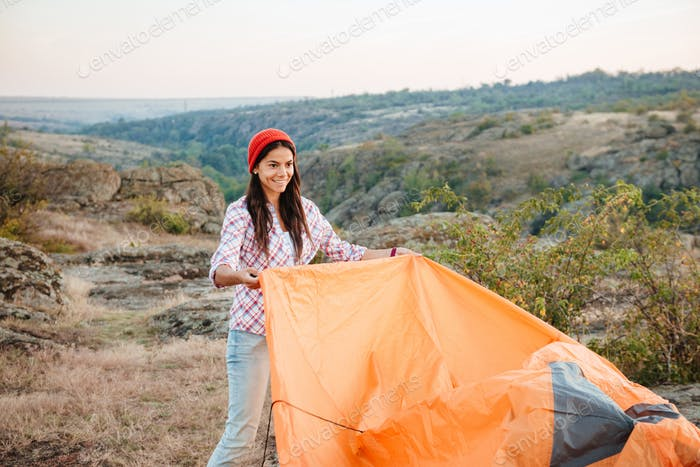 Young girl collect tent