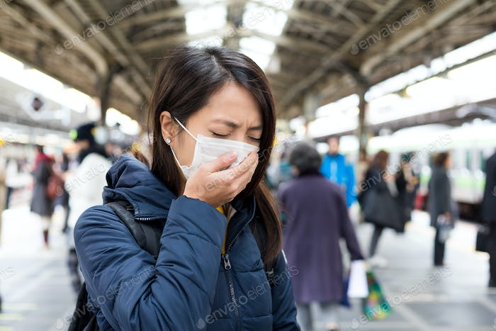 Woman wearing with face mask at train station