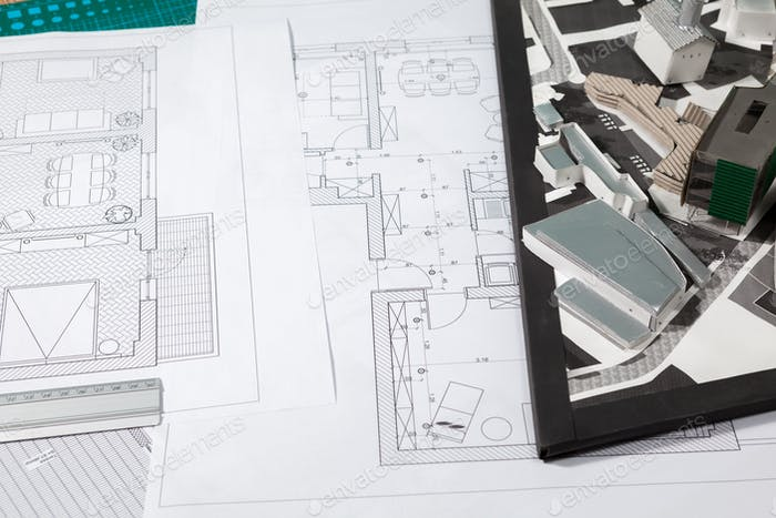 Building blueprints on an architect table