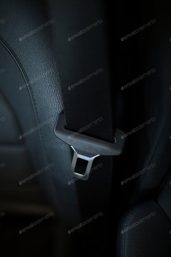 Close up of seat belt in car