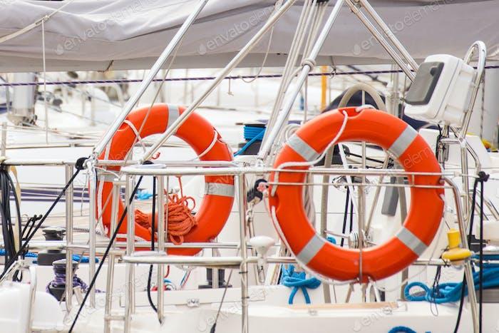 Parts of yacht, Orange lifebuoy on sailboat, safety travel concept