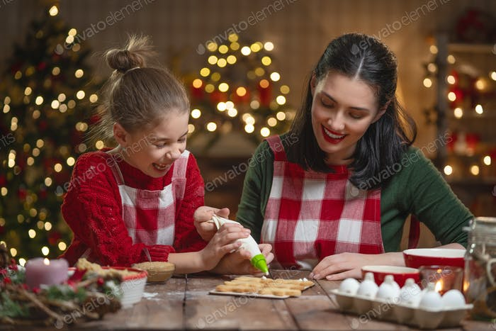Family cooking Christmas cookies.