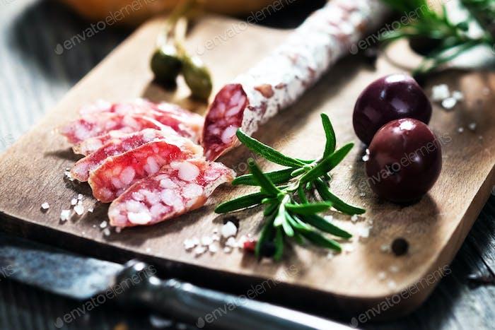 Sliced  Salami and olives