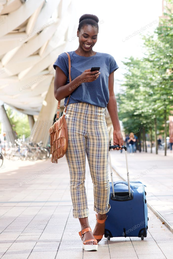 Full body portrait of happy young african american travel woman