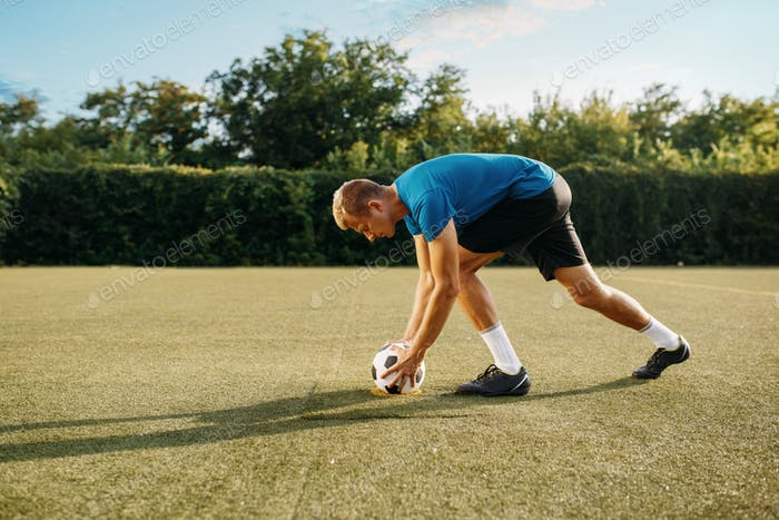 Male soccer player prepares to hits the ball