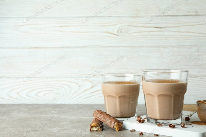 Concept of delicious food with chocolate milkshake on gray table