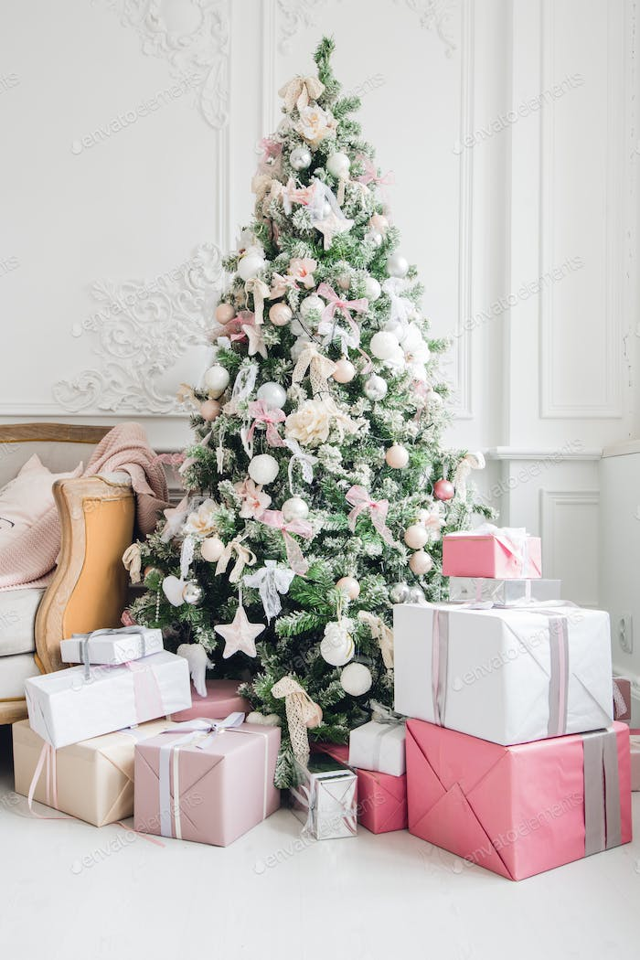beautiful modern design of the room in delicate light colors decorated with Christmas tree and