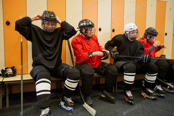 Female Hockey Team Getting Ready in Locker Room