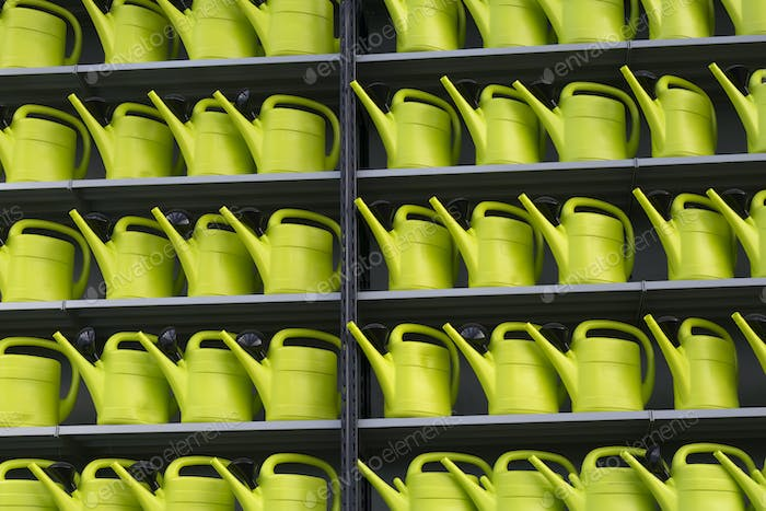 Rows of green watering cans for decoration