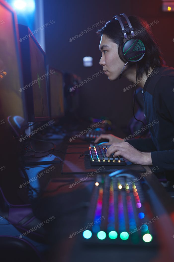 Asian Man Playing Video Game