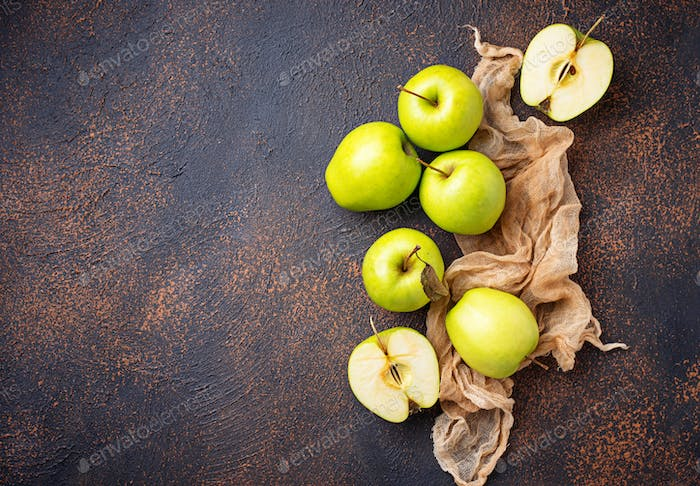 Fresh green apples on rusty background