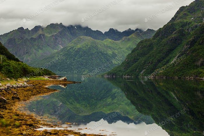 Idyllic view of mountains by calm lake