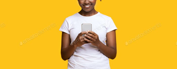 Unrecognizable black girl with modern smartphone, cropped