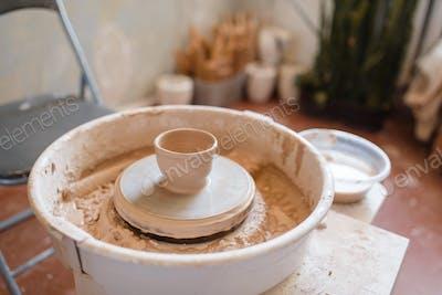 Pottery wheel with clay pot, nobody