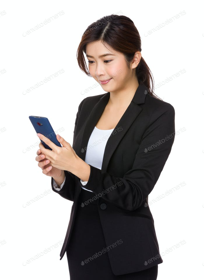Businesswoman read the message on cellphone