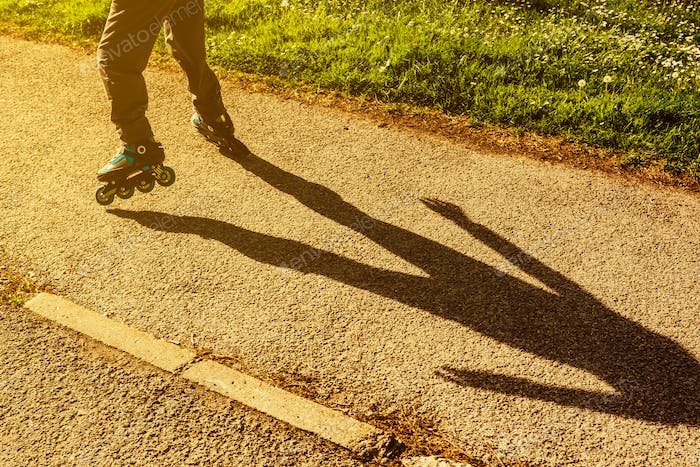 Boy riding roller blades on the street