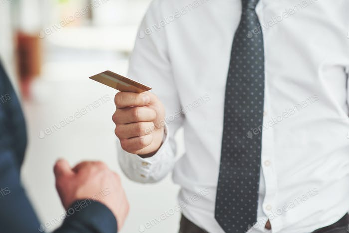 plastic card in the hands of a man