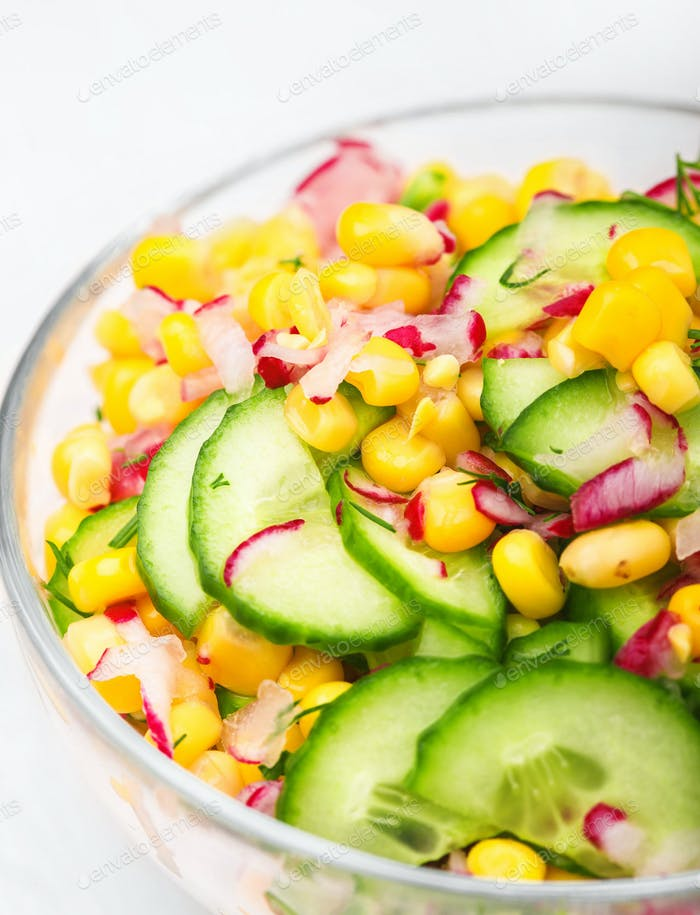 Food vegetable salad with corn and cucumbers healthy green meal