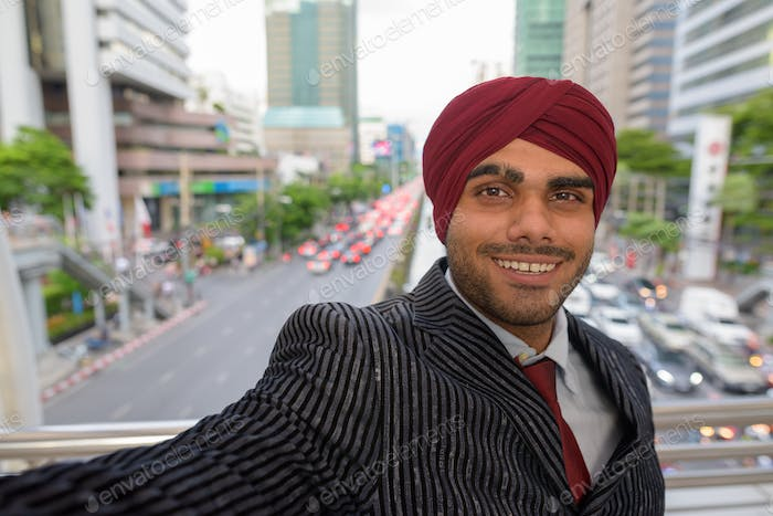 Personal point of view selfie of Indian businessman in city