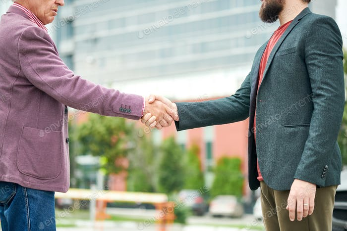 Thumbnail for Two Business People Shaking Hands