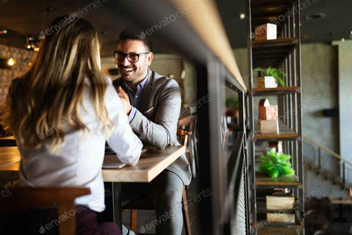 Happy romantic smiling people having date in restaurant. Couple in love
