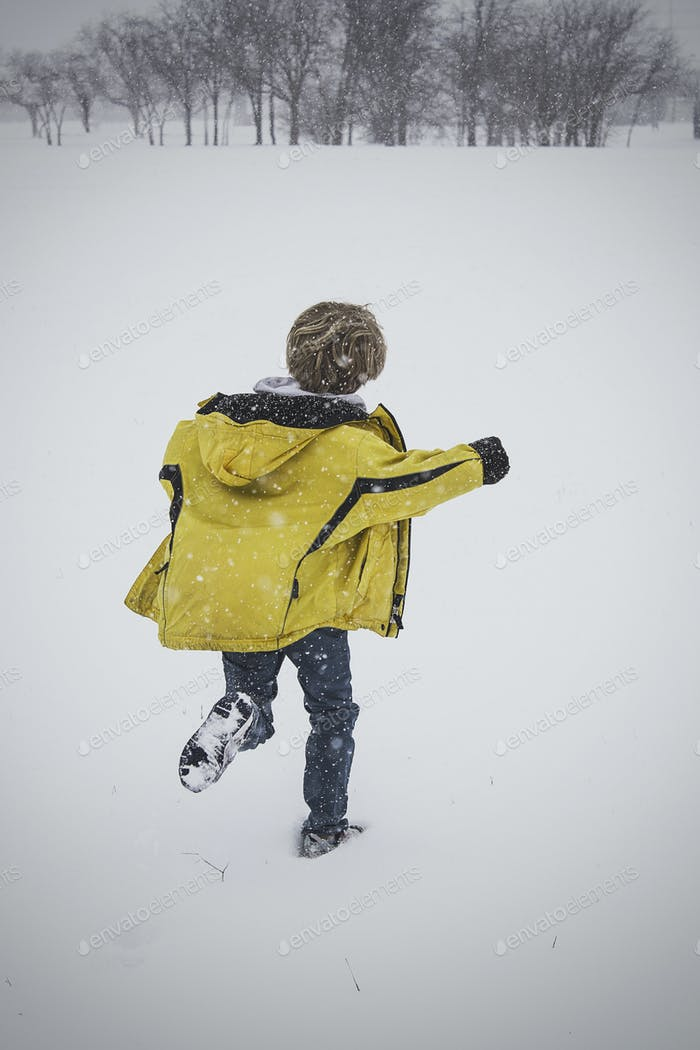 Child Running Through Snow