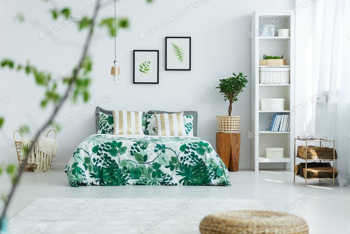 White bedroom with bookcase