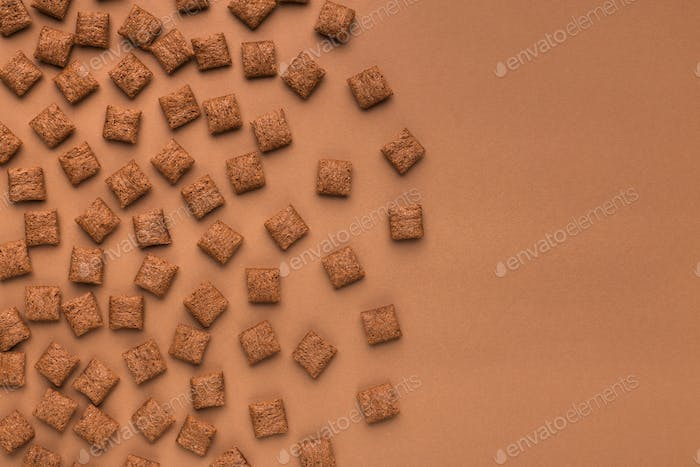 Top view of cereal pillows on brown background