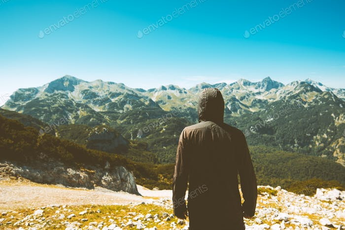 Mountain hiker looking into beautiful landscape