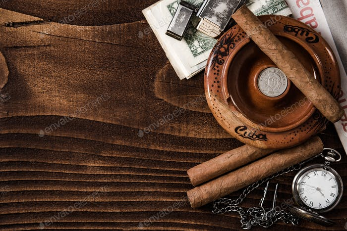 Cuban items,cigars watch on wooden table