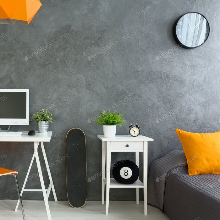 Grey modern bedroom with orange accessories