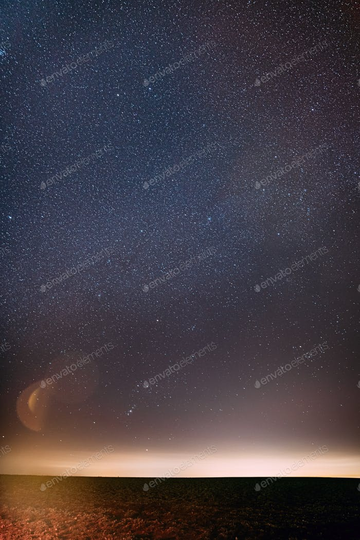 Night Starry Sky With Glowing Stars Above Countryside Landscape. Milky Way Galaxy Sky
