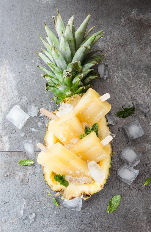 Frozen pineapple popsicles