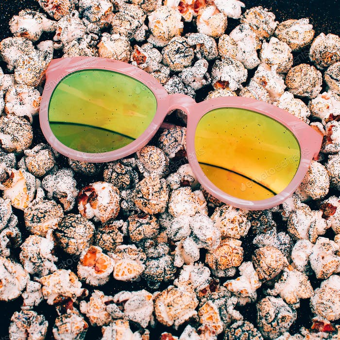 Sunglasses on the popcorn background Minimal fashion