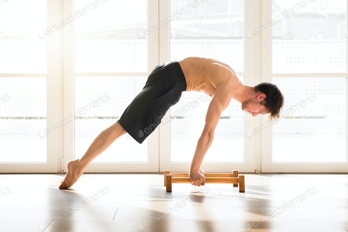 Fit young man doing a calisthenics planche pose