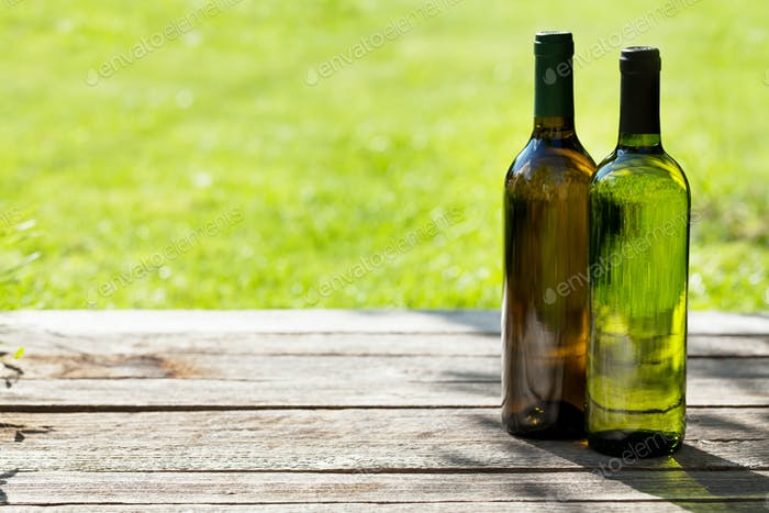 White wine bottles on wooden table