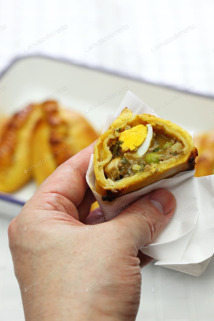 saltena, bolivian juicy filling empanada