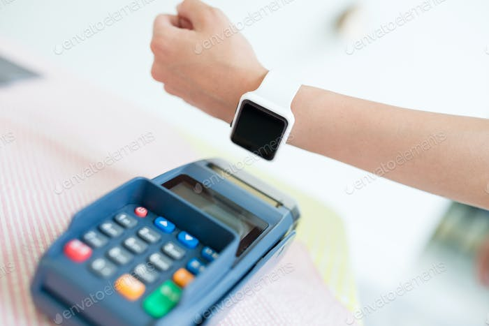 Woman using her smart watch to pay