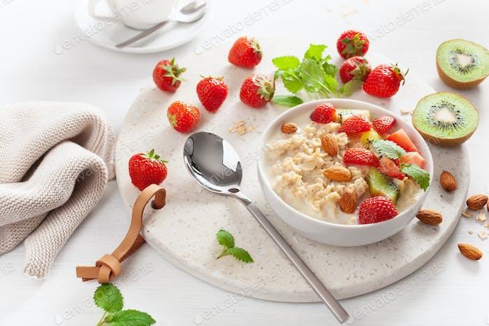 healthy breakfast oatmeal porridge, strawberry, nuts