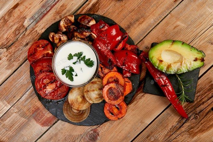 Grilled vegetables on black background. Diet vegan food.