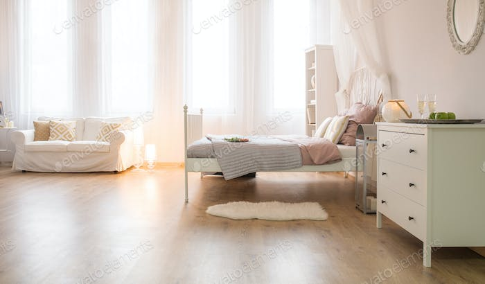 Room with sofa and bed