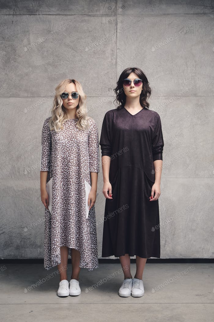Two attractive girls in summer fashion dress