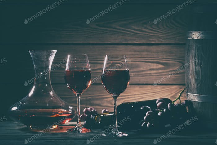 Wine still life with red wine in glasses and grapes