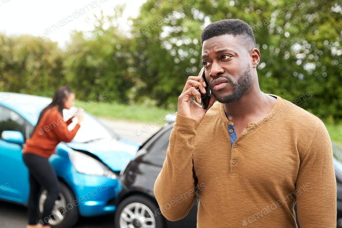 Male Motorist Involved In Car Accident Calling Insurance Company Or Recovery Service