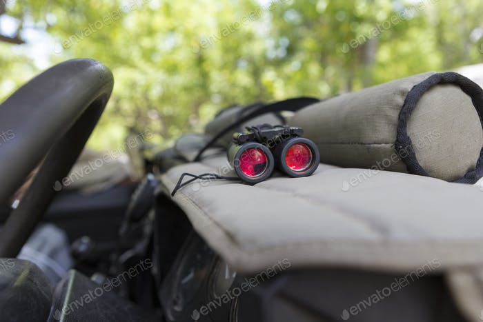 Binoculars on the dashboard of a safari jeep.