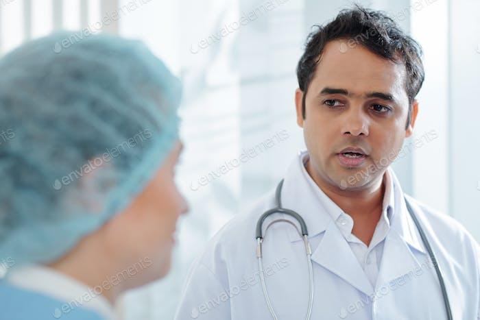 Gp talking to nurse