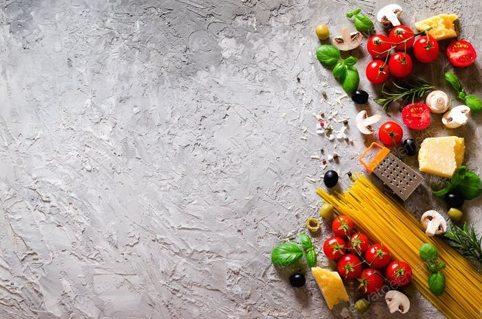Food ingredients for italian pasta, spaghetti on grey concrete background. Copy space of your text