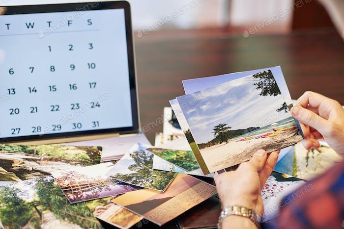 Traveler checking printed photos