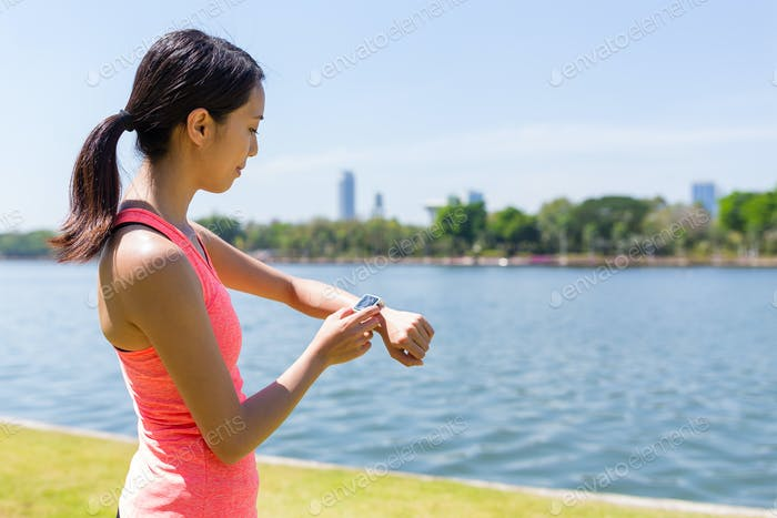 Woman use of smart watch for training exercise