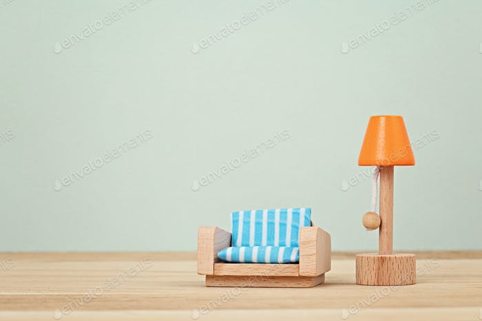Interior imitation with wooden toy furniture for chilldren. Interior design mock up, natural